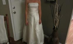 Alfred Angelo wedding dress, ivory, size 4. Pictures show train bustled. Was purchased at The Wedding Place and original dress bag included. No stains, no damage, condition as if never worn.