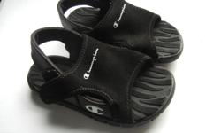 black, like new, slips on by opening the top of the sandal, then velcro it closed.