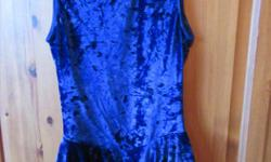 In very good clean condition, would best suit a girl aged 11-13. Beautiful royal blue skating dress. Has a pretty cut out in the back.