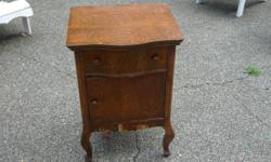 """Small oak cabinet for sale. 20"""" wide x 18"""" deep x 30"""" high. Drawer and single door. Ideal for bedside table or end table. $75.00"""