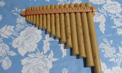 SMALL PAN FLUTE ABOUT 8 INCHES LONG. GOOD CRAFTSMANSHIP ALSO CHECK MY SELLERS LIST. PHONE ONLY