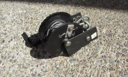 600 lb winch new condition with cable $ 15 ph 250 514 4429