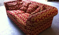 """Large Sofa. Six cushions.Very good condition. Measures 84"""" long, 45"""" deep and 30"""" high. Red and gold diamond pattern."""