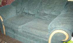 "Free sofa. Approx. 72"" long, green, has rip in one arm(check picture) You pick up."