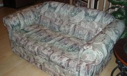 Sofa and matching loveseat for sale.  Light multi-coloured fabric.