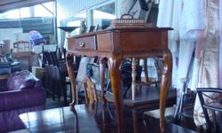 Sofa table with draw make is Bombay company. Good condition. Length 48 inches, width 16 inches by 26 inches in height. Email 9 am till 6 pm. Phone 6:30 pm till 10 pm. Thanks.