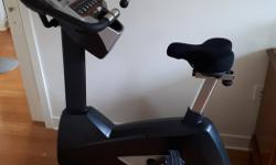 Like-new exercise bike for sale. Self-powered so it can be used anywhere. includes 40 levels of resistance and a 14.1 kg (31 lb.) flywheel, making a nice, smooth transition between resistance levels. 10 workout programs. Built-in speakers. Very
