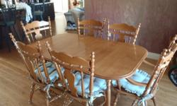 Solid maple dining room set for sale. Comes with two arm chairs and 4 regular chairs (cushions included). Table comes with two leaves. Seats up to ten comfortably. Measurements:  64 x 42        No leaves 82 x 42        One leaf 100 x 42      Two leaves