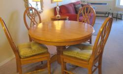 """42 """" round table with 4 solid chairs. Table has internal leaf and easily expands to seat 6 or more. Gently used, senior lady moving and cannot take with. $1000 new. See ads for Crimson Pull out Sofa Bed and Mirrored Dresser."""
