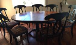 Solid Maple - 2 two tone, with blue, dining table. Comes with leaf and 8 chairs. Fabric cushion seats.