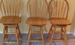 3 wooden swivel bar stools in excellent condition. Seat is 24 inches high. 75.00 for all 3 chairs.