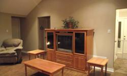 Solid oak custom made entertainment centre.  Entertainment centre has smoked black glass doors with 3 smoked glass shelves.   $600 or best offer   Call or email   If you want entire set with coffee tables and end tables $850.00 - the coffee table has a