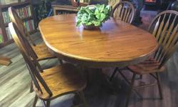 Excellent condition solid oak pedestal table with 4 chairs. 41 inch round table extends to 59 by 41 oval with leaf. Serious enquiries only please. Make an offer (available Nanaimo to Port Alberni)