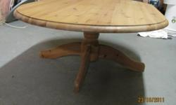 Solid oval pine coffee table for sale - excellent condition - $85   Would consider delivery for small charge. Contact if interested.