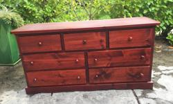 this is a really nice dresser made from solid pine in excellent condition. the drawers all slide like new and its from a non smoking no pets home. I can deliver. 250 208 3174 mirror not shown 58 x 18 x 30 high