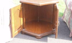 The end table and coffee table are made of solid pine.  They have a few minor scratches but are in very good shape.  They are price to sell for we do not want to store them.