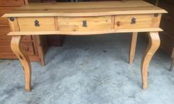 this is a beautiful table that could be used for a number of things. its very well made and in excellent condition from a non smoking no pets home. I can deliver. 250 208 3174 48 x 23 x 30 high