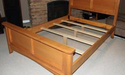"""Full/Double bed frame, about two years old, made of Maple. Dimensions are 75 1/2"""" long and 54 3/4"""" wide - inside dimensions. Has one dent in headboard, see photo. Does not include mattress."""