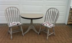 This solid wood dining table is perfect for a small eating area. Pair it with these grey cushioned chairs and you're set. Table $150 Chairs $55 each or $100 for the pair