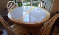 Solid wood/tile table and 4 chairs, white and light wood in colour, great condition.