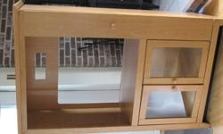 """We have a tall, solid TV stand for sale, in great condition. Bought new at Keltic Furniture for 350.00+. It measures 5' high, 3' wide and can hold up to a 27"""" TV. There is an upper shelf for components, closed DVD and CD shelving on one side, and a roomy"""