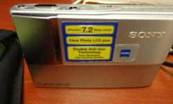 A silver Sony Cybershot digital camera for only $30 - in perfect, working condition. Still has original decals on it. Includes green camera case, USB, hdmi, charging cables, Lithium battery and memory card. Available now - please email or call.