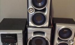 """3 CD disc exchange, 2 cassette players, radio tuner, 1 8"""" sub-woofer, 2 speakers, remote"""