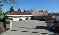 # Bath 4 Sq Ft 6113 MLS 414560 # Bed 5 Amazing one owner home sitting on a completely useable .66 acre with 100 feet of east facing walk on waterfront! The massive 6,100 square foot home has all generous living areas and a total of 5 bedrooms + den. Main