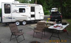 20 ft travel trailer,in mint condition, only used 12 times. Has large picture window in dinning area, large refrigerator and freezer uses electric or gas, large stove with oven, water heater gas or electric, large air conditioner, bathroom with tub,