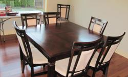 """Square dining table and eight chairs, 5 years old. Table is 54"""" X 54"""". Centre folds in to make 36"""" X 54"""". Table is normal height 32"""""""