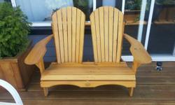 We have a stained Adirondack loveseat for $110. This is less than a year old but we are moving to a condo so we need to downsize! Please text 306-716-2568 or email ad if interested. p.s. if you have already emailed us about this chair and didn't get a