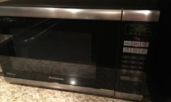 Panasonic Stainless Steel Microwave. Excellent Condition. Works perfectly! with tax paid close to $200 but letting it go cheap as a moving out sale.