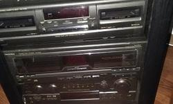 Stereo Techniques including case, amp, CD Changer (for 60 CDs), 2 tape players, Sony record player, 5 speakers