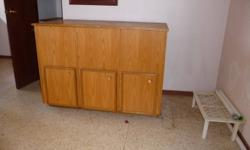 """Oak finish storage cabinet. 3 doors on bottom, top opens up. Made to store larger items. 4' x 2' x 2'11"""" Good condition. OBO"""