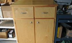 """Pine, clear stained cabinet for sale- 2 drawers, 2 doors 38""""W. 25""""D and 44""""H Great for storage"""