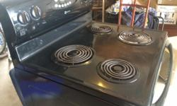 black Maytag stove with self cleaning oven. good condition.