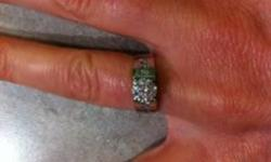 Engagement Ring- less than 5 years old, Custom design and made by KELLERS Jellewers Ltd., 14kt white gold diamond solitaire ring. Wide high shoulder design (6.5mm) with larger diamond set in center in 4 claw head and shoulder channel set with 3 smaller