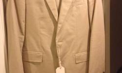 Tan Club Monaco Grant suit. Size 40R. Never worn tags attached. Original price was $350 for the jacket and $150 for the pants. This is a high quality suit with functioning buttons. Pick stitching around the lapel. Canvass construction. Perfect for that