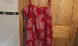 very cute summer dress, purchased from bluenotes - size XL (fits more like a L) in perfect condition ; tie up spaghetti straps very cute red and white pattern asking $5.00 check out my other ads :) over 95 ads up!! HUGE sale :)