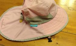 Kids Play Hat by Sunday Afternoons. Child size 2-5 but can be worn younger and older than specified range due to adjustable band. Quick release safety clasp and quick dry material. Lavender colour outside and purple inside. Great coverage and comfortable.