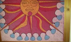 I painted this SUN in 1970 now 45 years ago...copied off of an Eddy Match Cover.. My father in law loved it so much he then made me this beautiful carved wooden frame as he just so happened to be a furniture carpenter. It was painted with Artex paint &