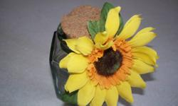 Sunflower Decorative Collection.     Located in srf, asking 20$ for the collection however i can sell items idividually if wanted.  In total theres 3 clay flower pots, one wall piece (triangle), one stubby glass jar with wide cork lid and bundle of