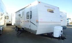 USED TRAVEL TRAILER   Stock Number: 9162A Length: 31 ft Flooring: Lino Sleeps: 8 Slide Out: 1 Exterior Colour: White Int. Colour: Dusty Rose / Gray Tones Exterior Material: Fiberglass   Options: DSI Water Heater Shower Oven LPG/CO2 Detectors Stove Bunk