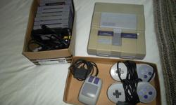 """Super Nintendo console and bundle including two (2) controllers, mouse, and nine (9) games: """"Killer Instinct"""", """"Wheel of Fortune"""", Donkey Kong country"""", """"Ninja Turtles IV"""", """"Mario Paint"""", """"Shaq Fu"""", """"Donkey Kong 3"""". This bundle is tested and all is in"""