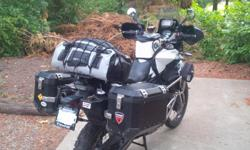 Set of Black Aluminum panniers (37l and 45l) with racks and mounting hardware for F800GS. This is a direct bolt on system, no modifications required. Retail cost $1370.00 +tax