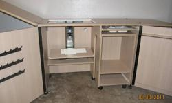 """Ideal combination: spacious and multi-functional when open and compact and mobile when closed. Barely used and in excellent condition. $800 or best offer. Dimensions: ? Open: 80"""" W x 19.5"""" D x 31"""" H ? Closed: 40"""" W x 19.5"""" D x 31"""" H ? Sewing machine"""