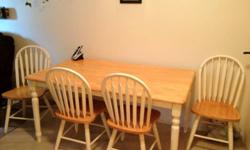 Dining table and 4 chairs. In good condition, barely used. Chairs need some white paint but are very solid and in its all in good shape. We never used it at all the 5 years I've own it. It's just collecting dust. This ad was posted with the Kijiji