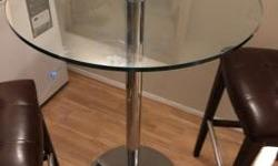 Glass bar table. Great condition. 2 leather chairs no rips. Nothing wrong with it just don?t have the space anymore. X posted Posted with Used.ca app