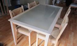 Kitchen size table and 4 chairs for sale.  Light finish, woven chairs with frosted glass top.  The set is in good condition and would be great for an apartment or kitchen area.  Asking $100 O.B.O.