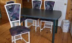 Green Hard Plastic Table 4 White Metal Chairs with fabric cushioning. Asking $150.00 OBO